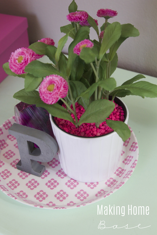 planter with pink pebbles