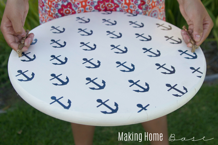 DIY Nautical Beverage Tray Tutorial on { lilluna.com } Super cute and easy to make. The perfect outdoor tray. Supplies include spray paint, a wood round, stencils, & drawer pulls.
