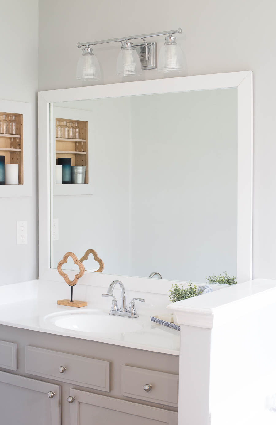 How To Frame A Bathroom Mirror In An Afternoon For Less Than $40!