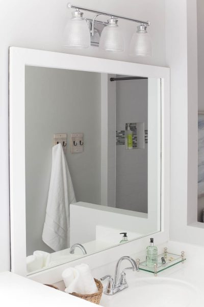 Upgrade a bathroom mirror with a DIY mirror frame