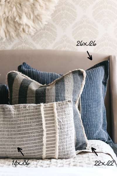 Styling throw pillows on a bed
