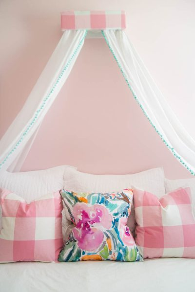 This little girls room is just precious! The green bed, pretty pillows, and DIY canopy are totally princess worthy!