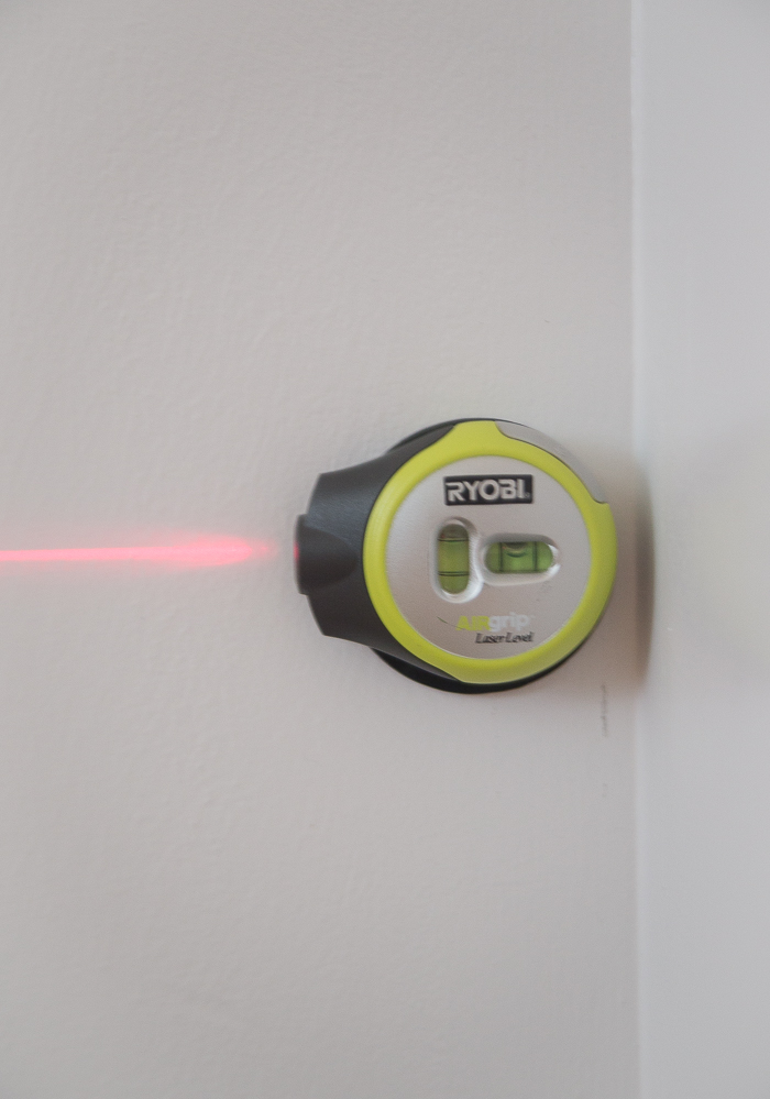 Using a laser level to create a wall treatment