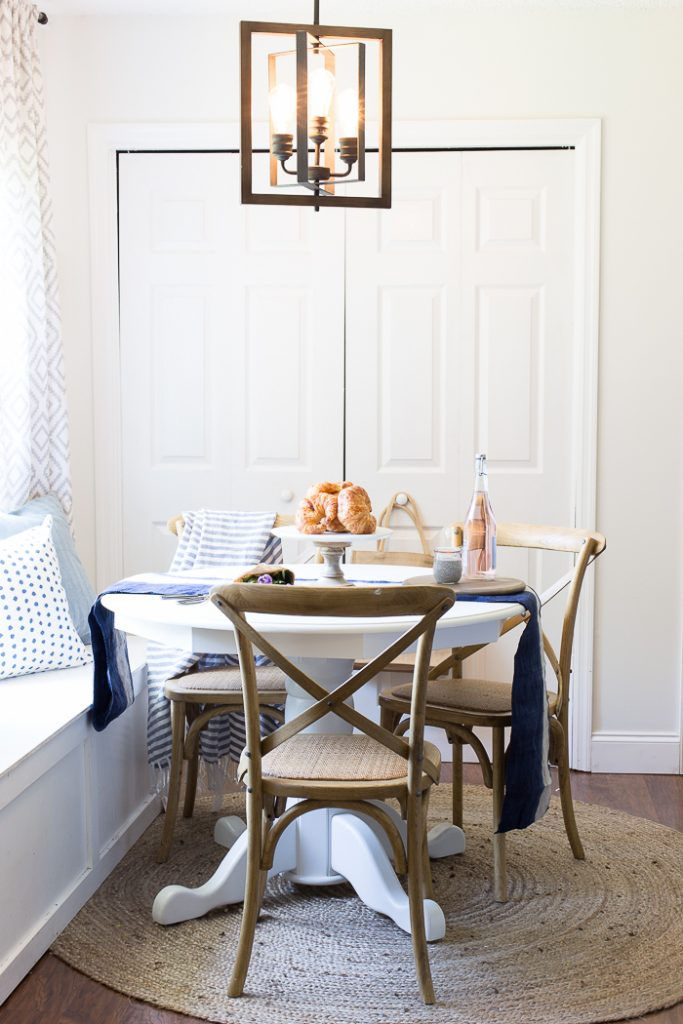 Vintage bulbs, white walls - light bright and gorgeous breakfast nook