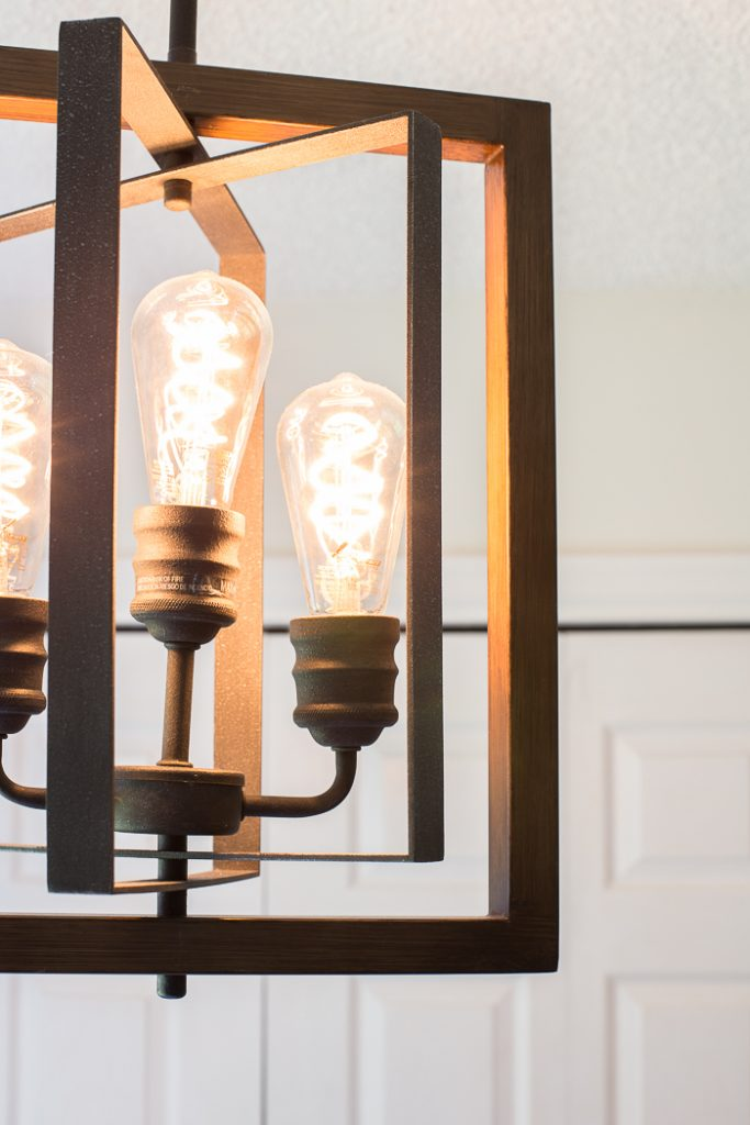 Breakfast nook brightened up with vintage light bulbs and a gorgeous light fixture