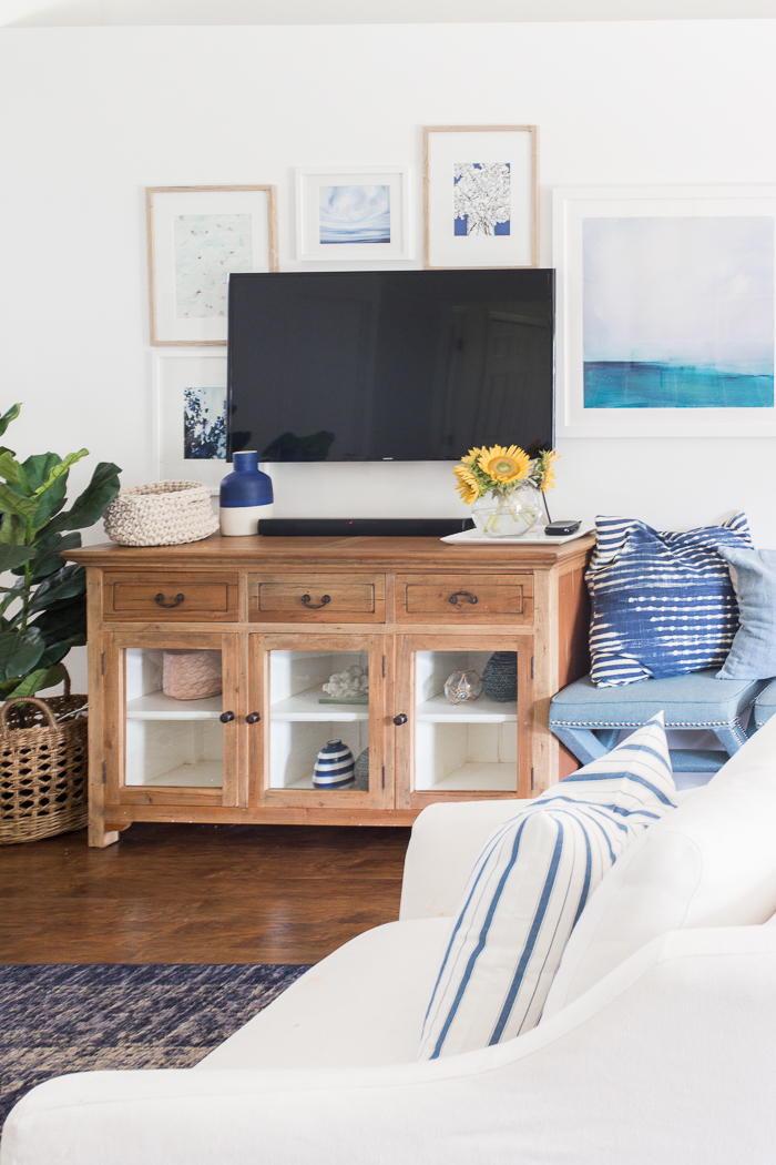 Coastal inspired gallery wall around TV