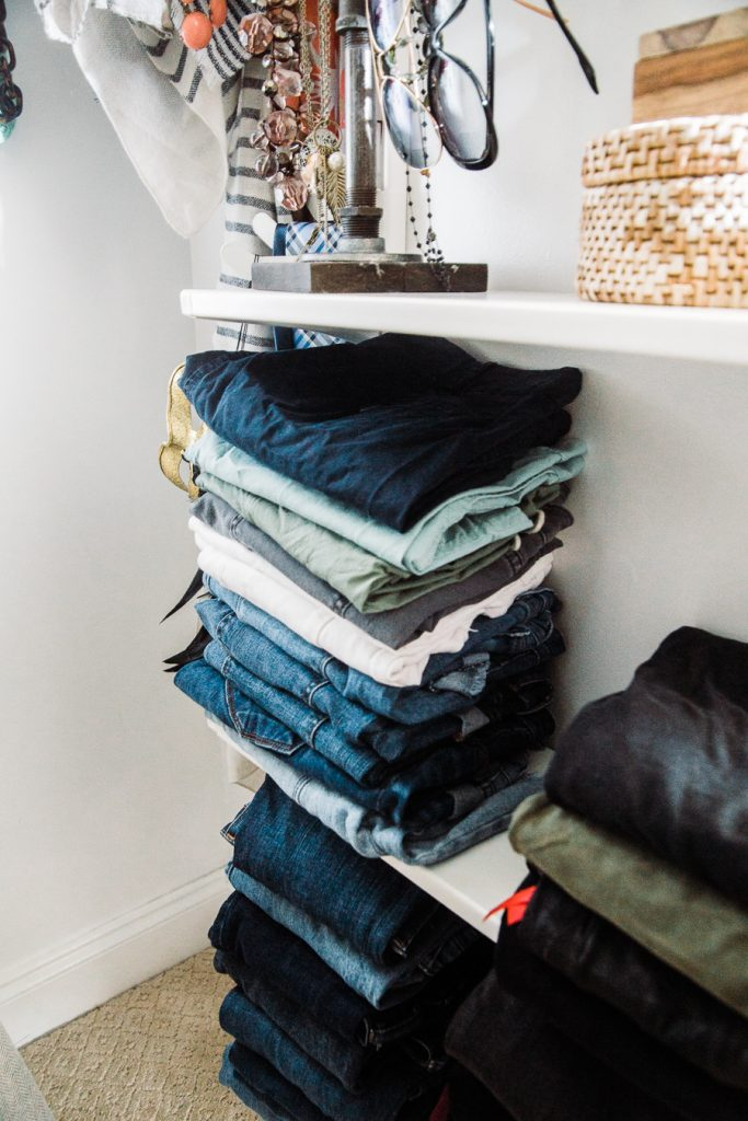 organizing a small walk in closet with shelving