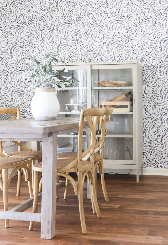 Coastal Inspired Dining Room with gray washed table, natural wood bistro chairs.