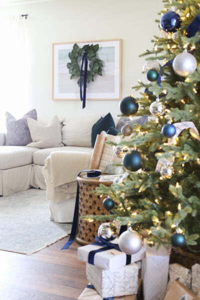Blue and Green Decorating Christmas Tree and White sofa with blue and green pillows