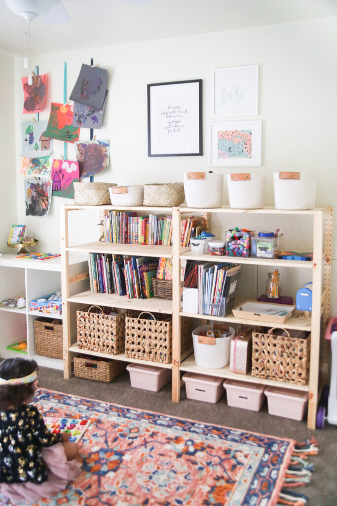 Kids Playroom Ideas - Affordable wood shelf packed with pins and baskets for ultimate organization