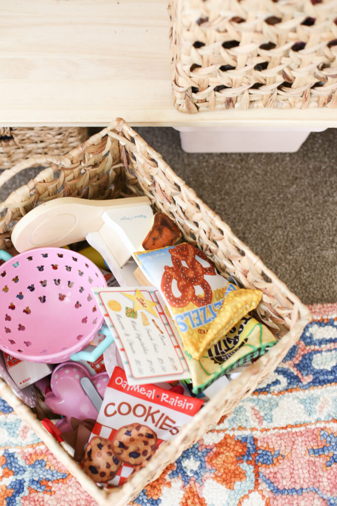 Kids playroom idea - store larger like items in baskets and bins like play food, dolls, etc.