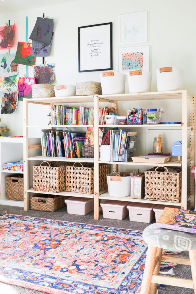 Organized Kids Playroom Ideas - organize everything in baskets and bins on a shelf or cubby system for a simple and affordable solution.
