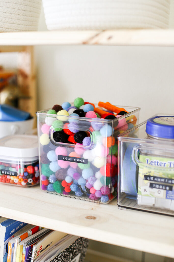 Kids playroom ideas - use clear containers and label art supplies.