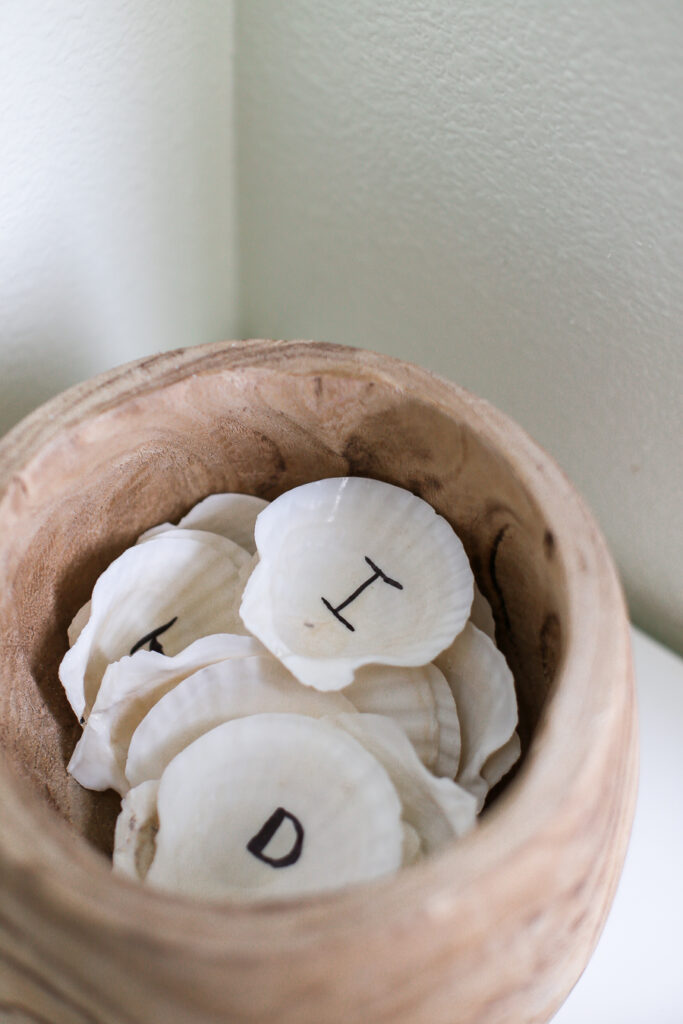 Use shells as learning tools by writing letters on the back. Great for play too in a kids playroom.