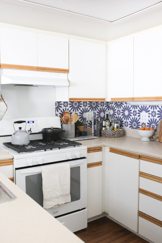 How to install this blue and white cement tile peel and stick backsplash in a rental kitchen. Perfect temporary backsplash solution to update an outdated kitchen.