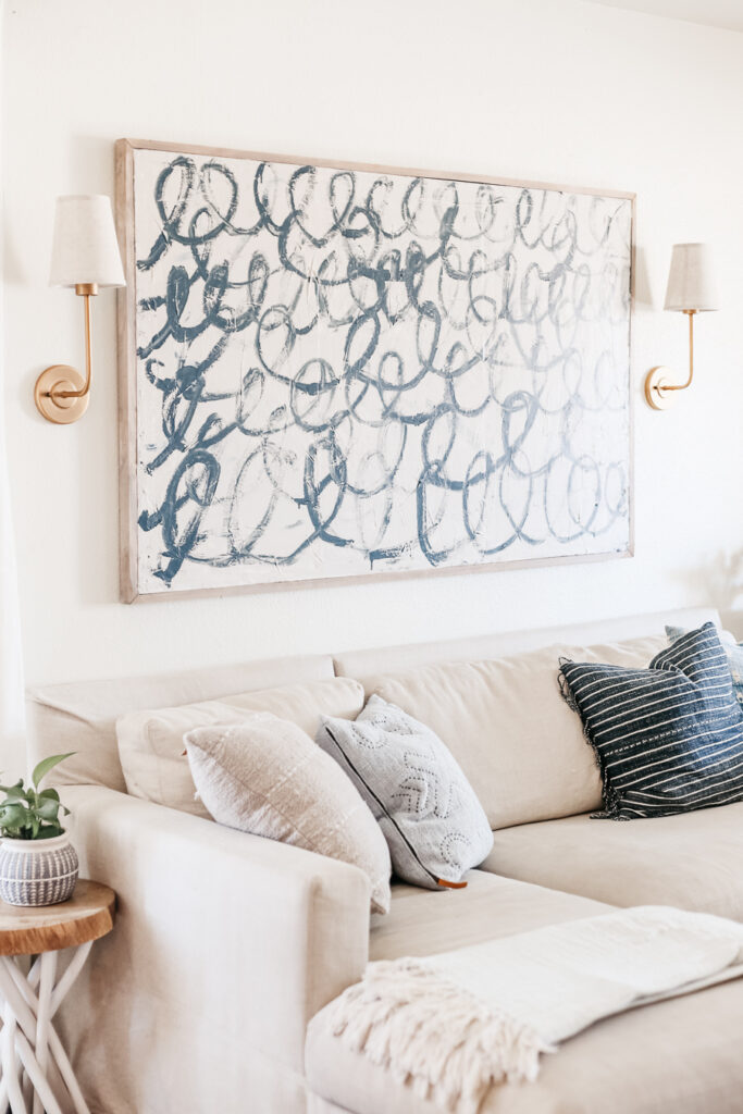 This DIY Canvas Painting Tutorial shares how to actually make a DIY Canvas. Budget friendly large scale art that you can create yourself.