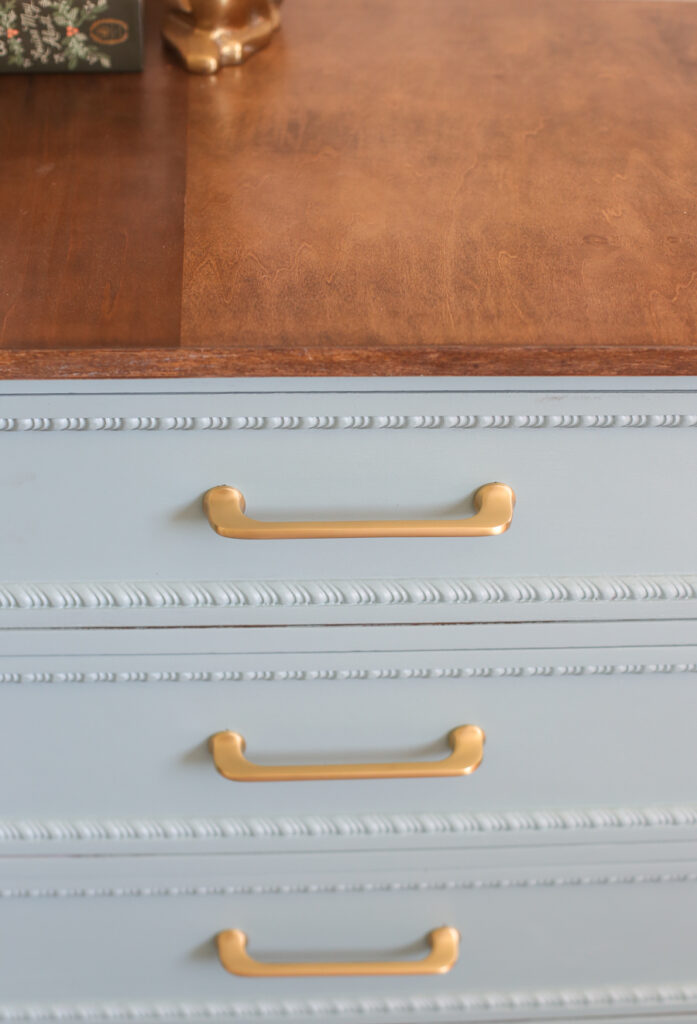 Updating an old dresser with blue paint and brushed gold pulls